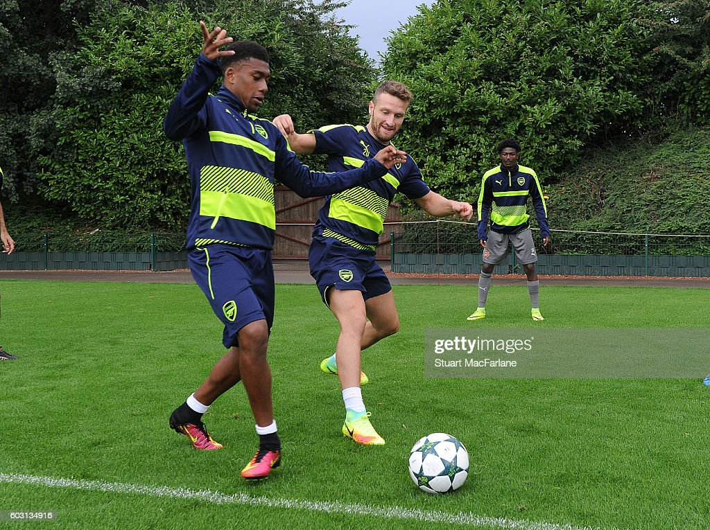 Alex Ixobi and Shkodran Mustafi of Arsenal during a training session at London Colney on September 12, 2016 in St Albans, England.
