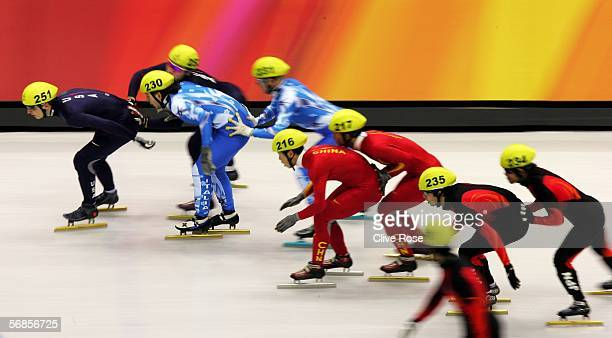 Alex Izkowski of USA Yuri Confortola of Italy Ye Li of China and Takahiro Fujimoto of Japan are all pushed by their fellow team mates as they make a...