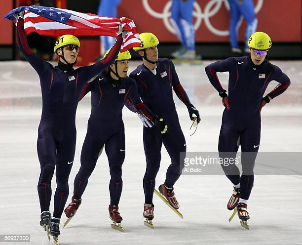 Alex Izykowski Apolo Anton Ohno Rusty Smith and JP Kepka of the United States celebrate winning the Bronze medal in the men's 5000 meter relay in...