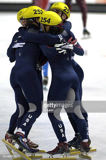 Alex Izykowski JP Kepka Rusty Smith and Apolo Anton Ohno celebrate during the Short Track Speed Skating 5000 m Relay at the 2006 Olympic Games held...