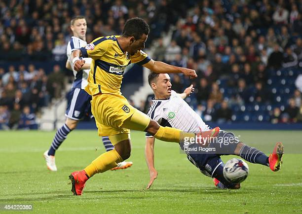 Alex Jakubiak of Oxford has a shot blocked by Jason Davidson during the Capital One Cup second round match between West Bromwich Albion and Oxford...