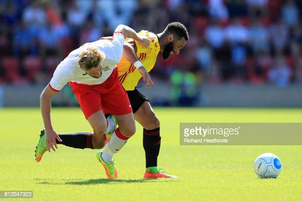 Alex Jakubiak of Watford battles with Joey Jones of Woking during the preseason friendly match between Woking and Watford U23 at the Laithwaite...