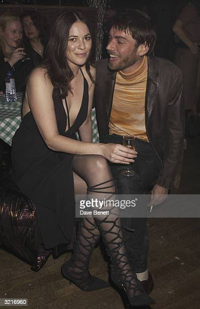 Alex James bassist with 'Blur' and his girlfriend at the UK premiere of 'The Lord Of The Rings The Two Towers' held on December 11 2002 at the Odeon...