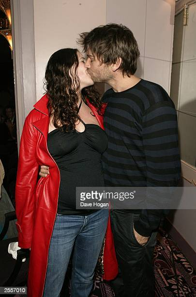 Alex James from Blur and his wife attend the Q Awards 2003 party at the Park Lane Hotel October 02 2003 in London