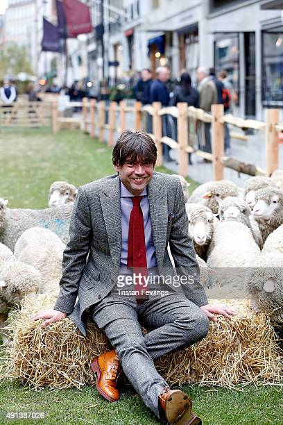 Alex James joins Bowmont Merino and Exmoor Horn sheep grazing the length of Savile Row to mark the launch of Wool Week 2015 with 'Sheep on the Row'...