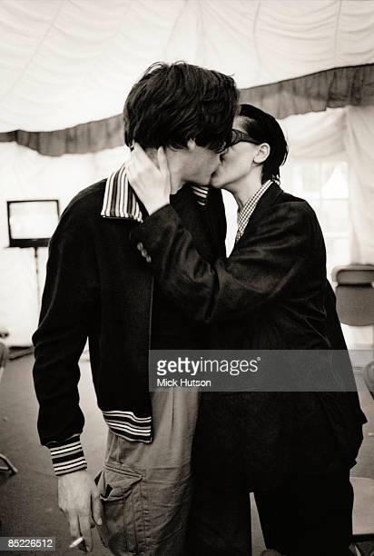 Alex James kissing Justine Andrew backstage at the RDS Showgrounds