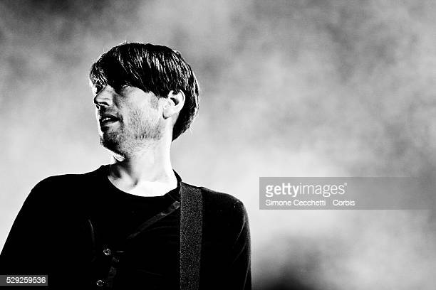 Alex James of rock band Blur performs during their live concert at the 'T in the Park' festival