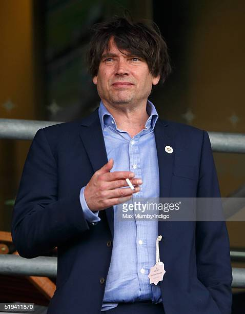 Alex James watches the racing as he attends the Prince's Countryside Fund Raceday at Ascot Racecourse on April 3 2016 in Ascot England