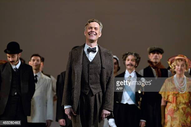 Alex Jennings salutes after a dressed rehearsal of the musical My fair lady based on George Bernard Shaws Pygmalion on December 2 2013 at the Theatre...