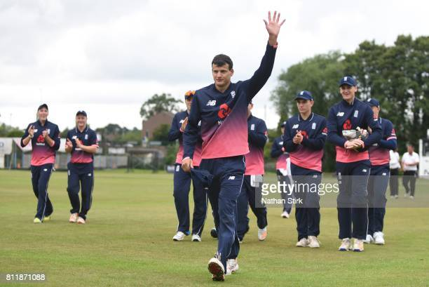 Alex Jervis of England is applauded of the pitch after taking five wickets during the INAS Learning Disability TriSeries Trophy match against England...