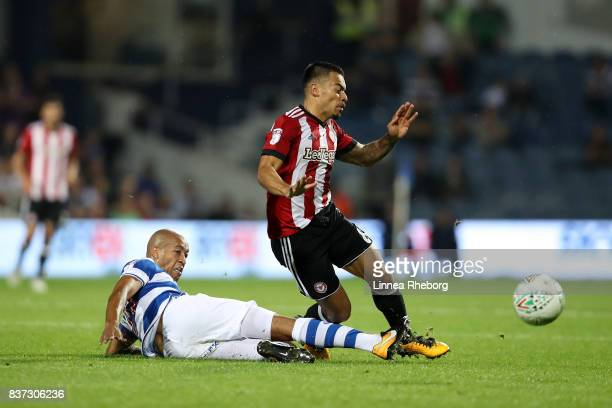 Alex JohnBaptiste of QPR tackles Nico Yennaris of Brentford during the Carabao Cup Second Round match between Queens Park Rangers and Brentford at...