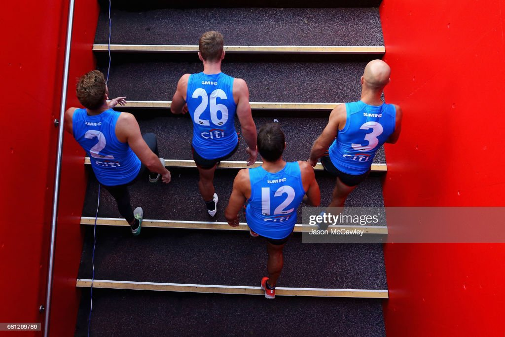 Alex Johnson, Luke Parker, Josh P Kennedy and Jarrad McVeigh of the Swans take to the field during a Sydney Swans AFL training session at Sydney Cricket Ground on May 10, 2017 in Sydney, Australia.