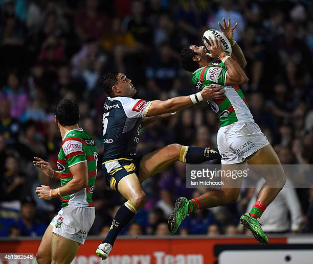 Alex Johnson of the Rabbitohs contests a high ball with Antonio Winterstein of the Cowboys during the round 16 NRL match between the North Queensland...