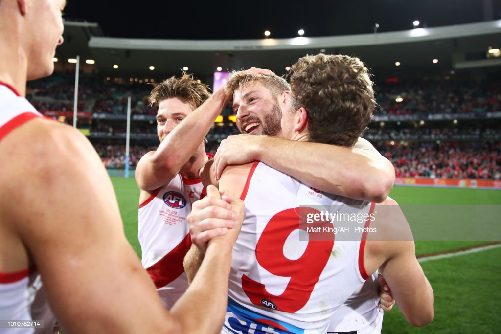 Alex Johnson of the Swans celebrates victory with team mates after the round 20 AFL match between the Sydney Swans and the Collingwood Magpies at Sydney Cricket Ground on August 4, 2018 in Sydney, Australia.