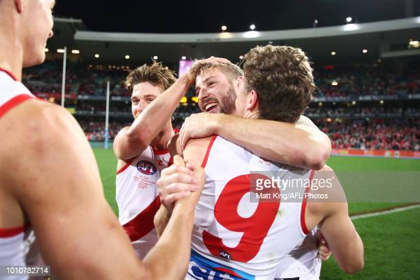 Alex Johnson of the Swans celebrates victory with team mates after the round 20 AFL match between the Sydney Swans and the Collingwood Magpies at...