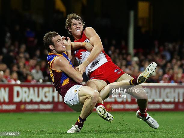 Alex Johnson of the Swans competes with Aaron Cornelius of the Lions during the round 24 AFL match between the Sydney Swans and the Brisbane Lions at...