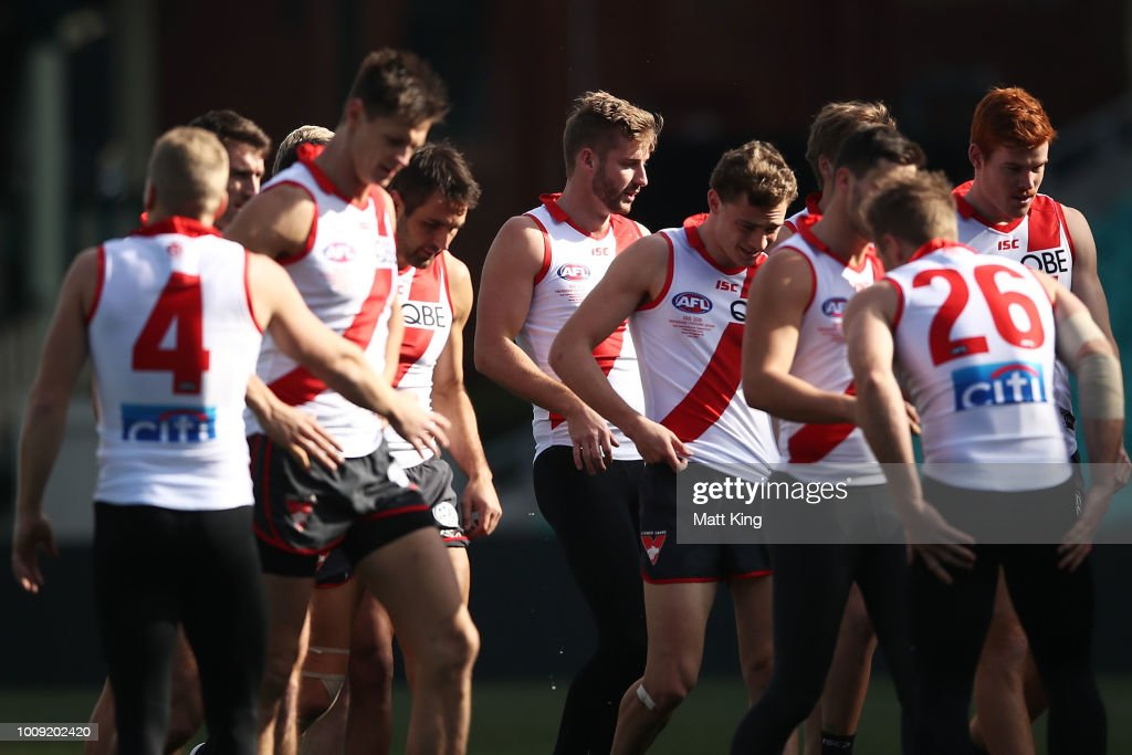 Alex Johnson (C) warmsup with team mates during a Sydney Swans AFL training session at Sydney Cricket Ground on August 2, 2018 in Sydney, Australia.