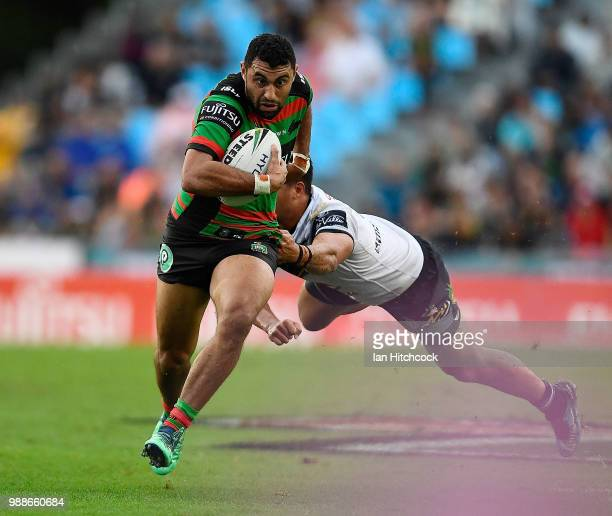 Alex Johnston of the Rabbitohs attempts to get past Kyle Feldt of the Cowboys during the round 16 NRL match between the South Sydney Rabbitohs and...