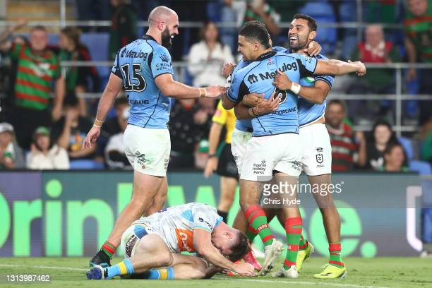 Alex Johnston of the Rabbitohs celebrates a try with team mates during the round seven NRL match between the Gold Coast Titans and the South Sydney...