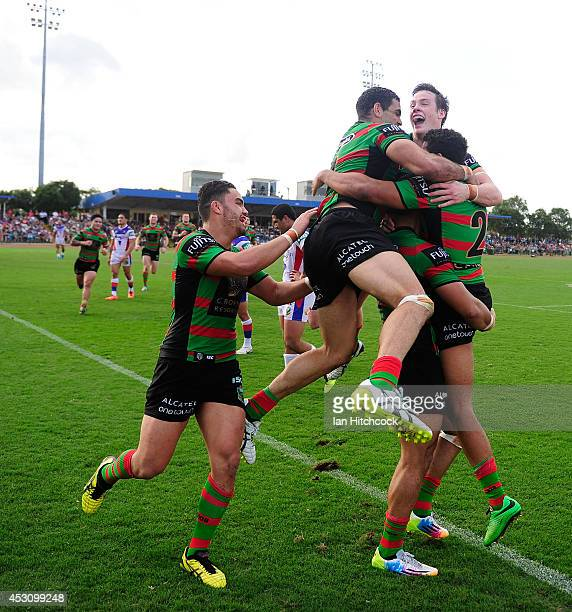 Alex Johnston of the Rabbitohs celebrates his try with team mates during the round 21 NRL match between the South Sydney Rabbitohs and the Newcastle...