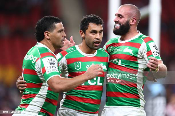Alex Johnston of the Rabbitohs celebrates with team mates after scoring a try during the round 24 NRL match between the Sydney Roosters and the South...