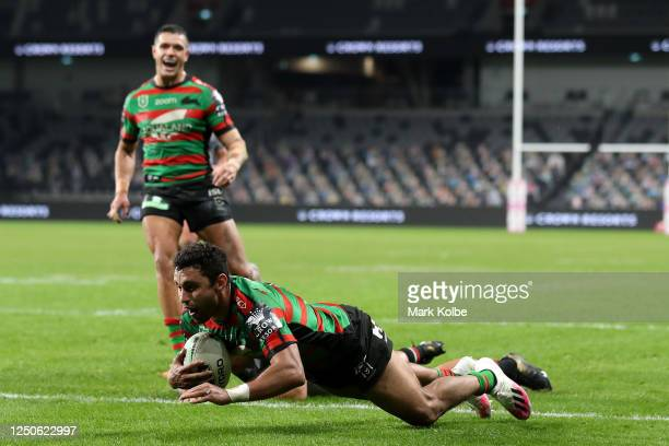 Alex Johnston of the Rabbitohs dives over to score a try during the round six NRL match between the South Sydney Rabbitohs and the New Zealand...