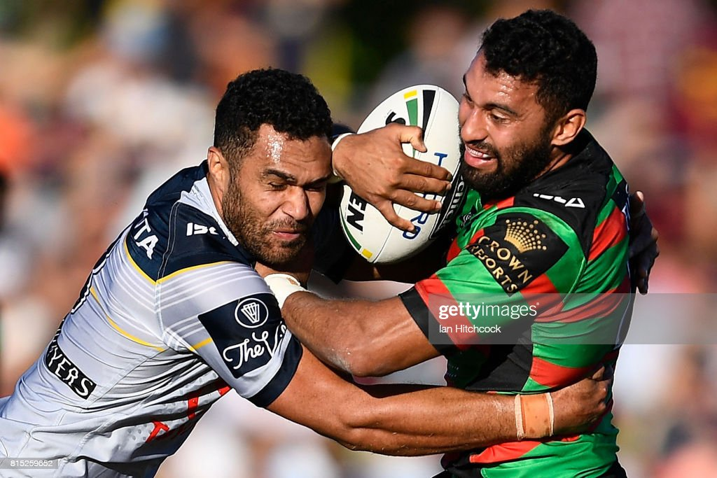 Alex Johnston of the Rabbitohs is tackled by Justin O'Neil of the Cowboys during the round 19 NRL match between the South Sydney Rabbitohs and the North Queensland Cowboys at Barlow Park on July 16, 2017 in Cairns, Australia.