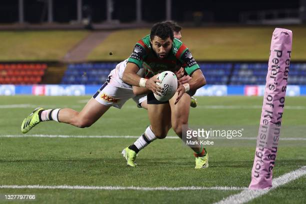 Alex Johnston of the Rabbitohs scores a try during the round 17 NRL match between the South Sydney Rabbitohs and the North Queensland Cowboys at...