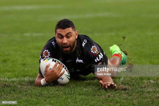 Alex Johnston of the Rabbitohs scores a try during the round 17 NRL match between the South Sydney Rabbitohs and the Penrith Panthers at ANZ Stadium...