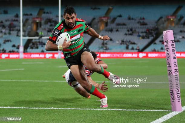 Alex Johnston of the Rabbitohs scores a try during the round 20 NRL match between the South Sydney Rabbitohs and the Sydney Roosters at ANZ Stadium...