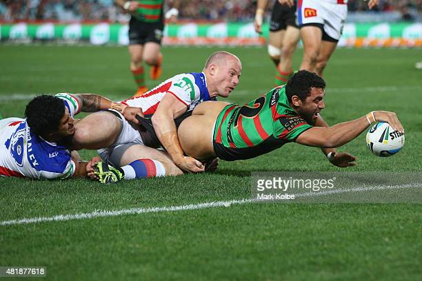 Alex Johnston of the Rabbitohs scores a try during the round 20 NRL match between the South Sydney Rabbitohs and the Newcastle Knights at ANZ Stadium...