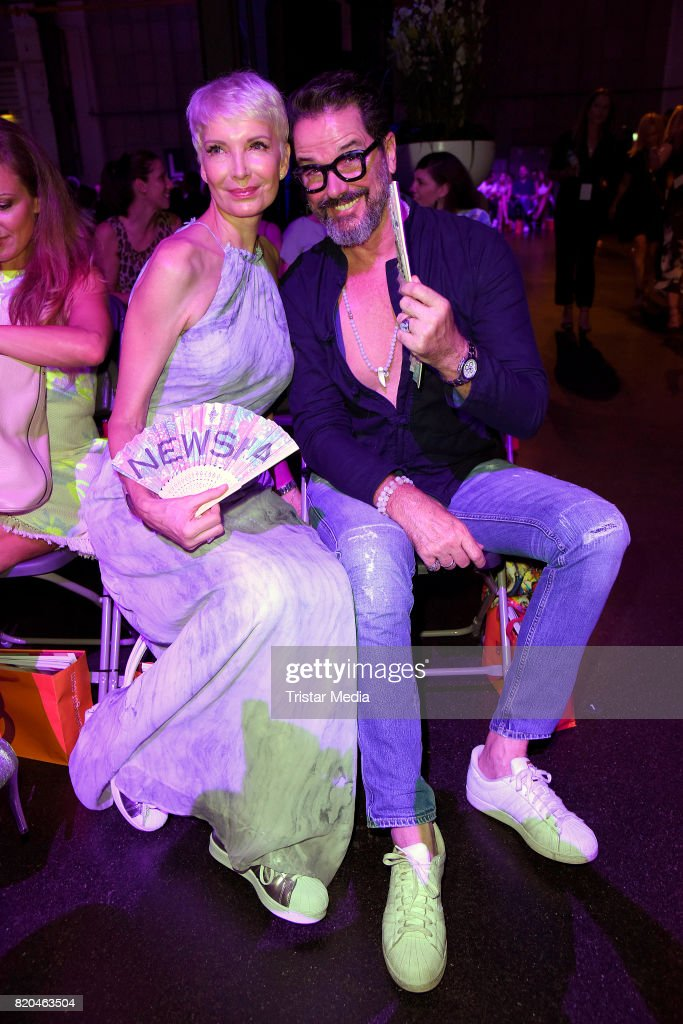 Alex Jolig and his wife Britt Jolig-Heinz attend the Breuninger show during Platform Fashion July 2017 at Areal Boehler on July 21, 2017 in Duesseldorf, Germany.