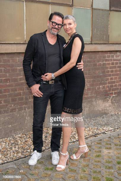 Alex Joling and his wife Britt JoligHeinz arrive at Plattform Fashion Breuninger on July 20 2018 in Duesseldorf Germany