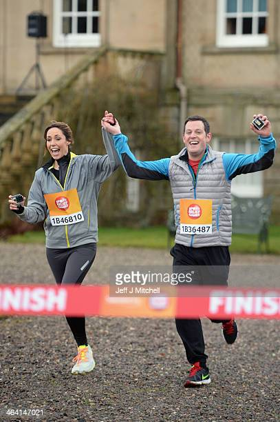 Alex Jones and Mark Baker from The One Show cross the finish line during The Dumfries House Sport Relief Mile officially started by Prince Charles on...