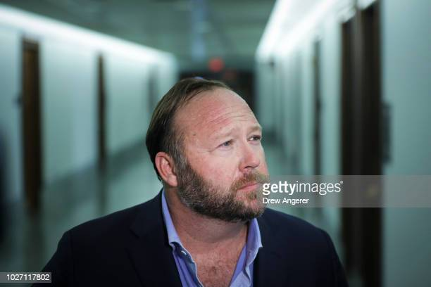 Alex Jones of InfoWars talks to reporters outside a Senate Intelligence Committee hearing concerning foreign influence operations' use of social...