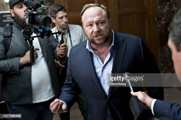 Alex Jones radio host and creator of the website InfoWars speaks to members of the media outside a Senate Intelligence Committee hearing in...