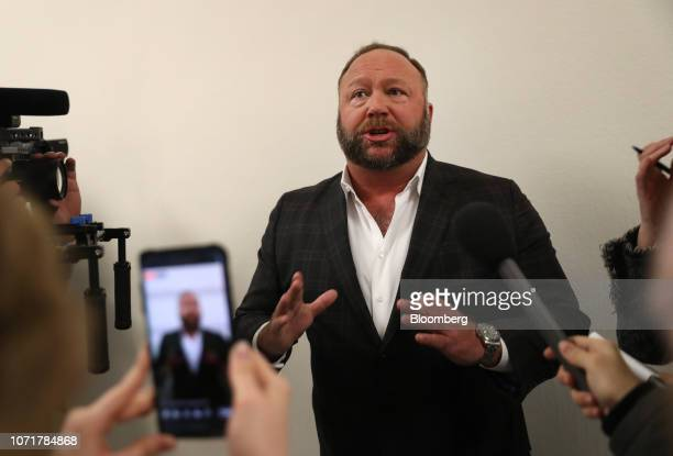 Alex Jones radio host and creator of the website InfoWars speaks to members of the media before a House Judiciary Committee hearing with Sundar...