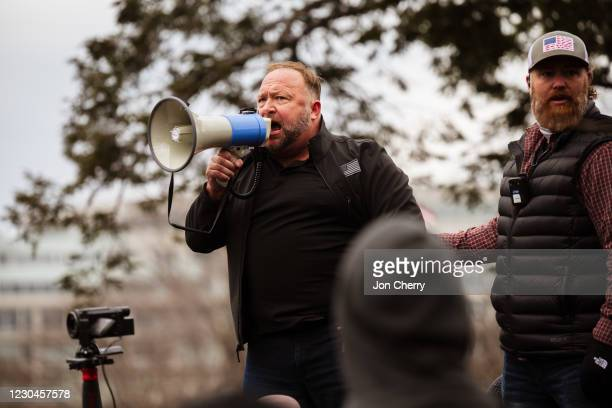 Alex Jones, the founder of right-wing media group Infowars, addresses a crowd of pro-Trump protesters after they storm the grounds of the Capitol...