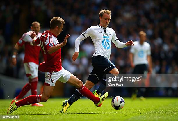 Alex Kacaniklic of Fulham tackles Christian Eriksen of Tottenham Hotspur during the Barclays Premier League match between Tottenham Hotspur and...