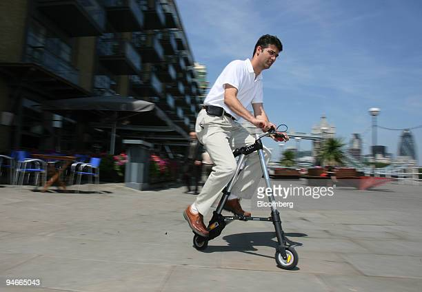Alex Kalogroulis the chief design engineer of the Abike a new lightweight folding bicycle demonstrates how to ride it at its launch in London UK...