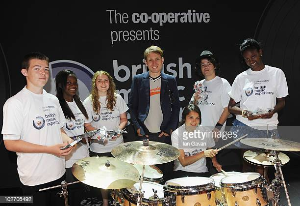 Alex Kapranos from Franz Ferdinand and pupils from Plumstead Monor and Eltham Green Schools attend the launch of The Cooperative partnership with...