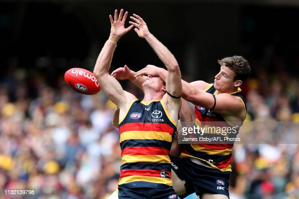 Alex Keath and Josh Jenkins of the Crows clash during the 2019 AFL round 01 match between the Adelaide Crows and the Hawthorn Hawks at Adelaide Oval...