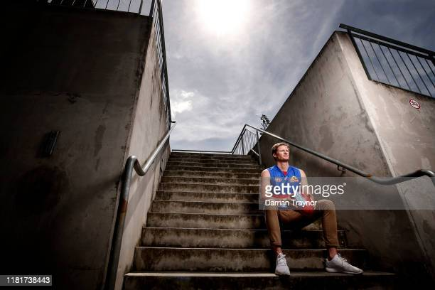 Alex Keath speaks poses for a photo before a press conference after signing with the Western Bulldogs at Whitten Oval on October 18, 2019 in...