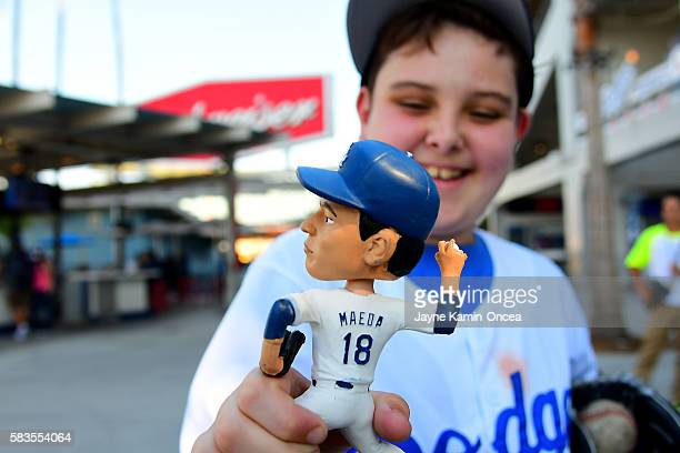 Alex Keith 10 years old shows off his Kenta Maeda bobblehead he received as part of the Japan night promotion for the game between the Los Angeles...