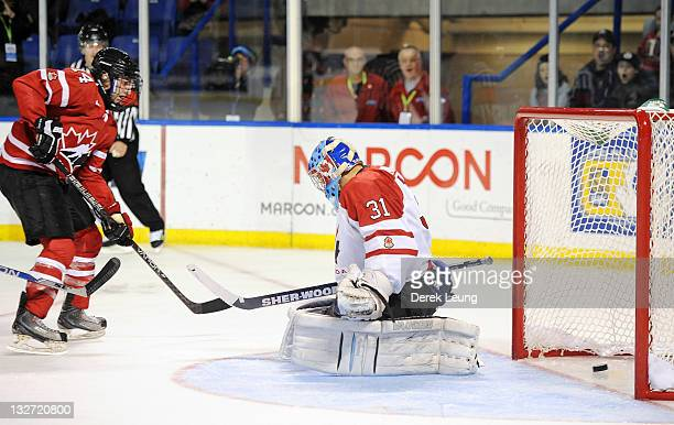 Alex Kerfoot of Canada West scores on Adrian Ignagni of Canada East at World Junior A Challenge at Langley Events Center on November 13 2011 in...