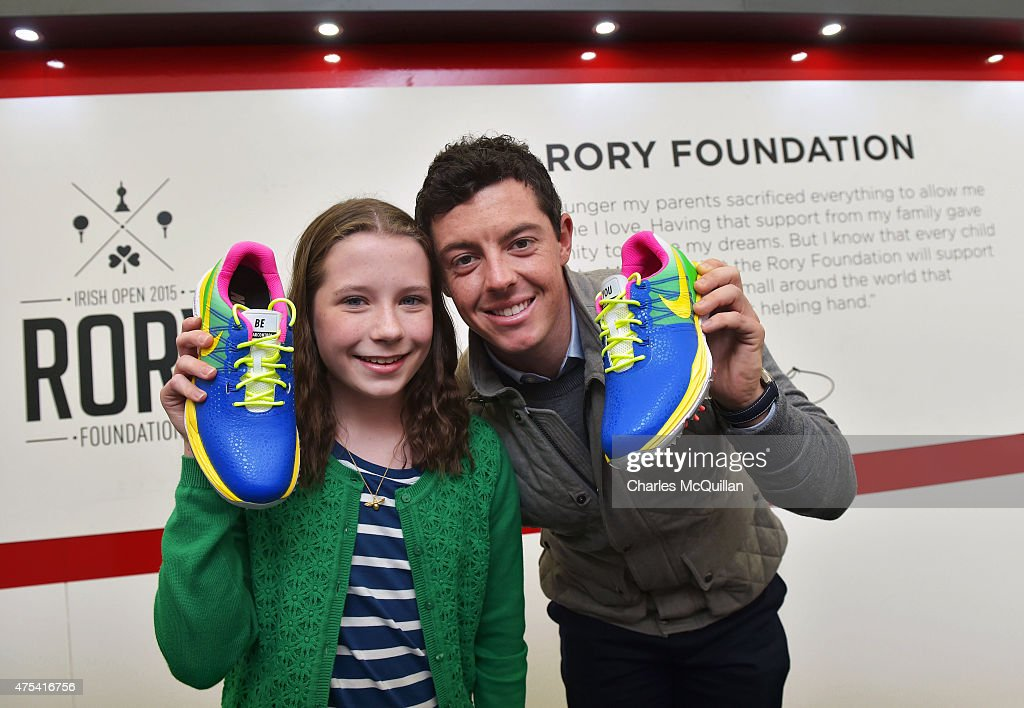 Alex Kernaghan (R) aged 12 who is supported by Cancer Fund For Children and who designed Rory McIlroy's Nike golf shoes for the final round of the Dubai Duty Free Irish Open hosted by the Rory foundation meets her hero, Rory McIlroy (L) in Rory's Bunker during Day Four of the Irish Open at Royal County Down Golf Club on May 31, 2015 in Newcastle, Northern Ireland. Rory McIlroy, The Rory Foundation and Nike teamed up with the Cancer Fund for Children in Northern Ireland to raise funds and awareness through the kid's designs. The four colorways that were selected were created by kids on NIKEiD during a weekend at the organization's Daisy Lodge log cabin.