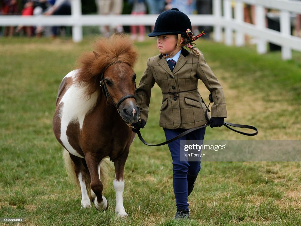 Alex Kersey, 8, from Rotherham competes with her miniature Shetland pony during the final day of the 160th Great Yorkshire Show on July 12, 2018 in Harrogate, England. First held in 1838 the show brings together agricultural displays, livestock events, farming demonstrations, food, dairy and produce stands as well as equestrian events. The popular agricultural show is held over three days and celebrates the farming and agricultural community and their way of life.