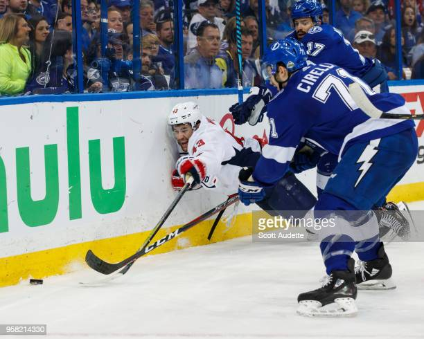 Alex Killorn and Anthony Cirelli of the Tampa Bay Lightning battle against Tom Wilson of the Washington Capitals during Game Two of the Eastern...