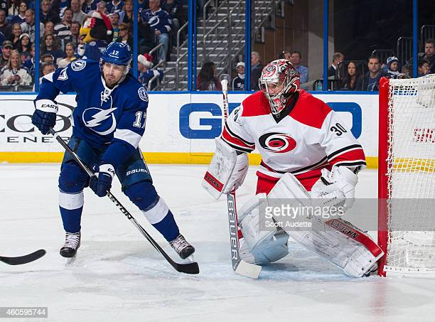 Alex Killorn of the Tampa Bay Lightning against battles against Cam Ward of the Carolina Hurricanes during the first period at the Amalie Arena on...