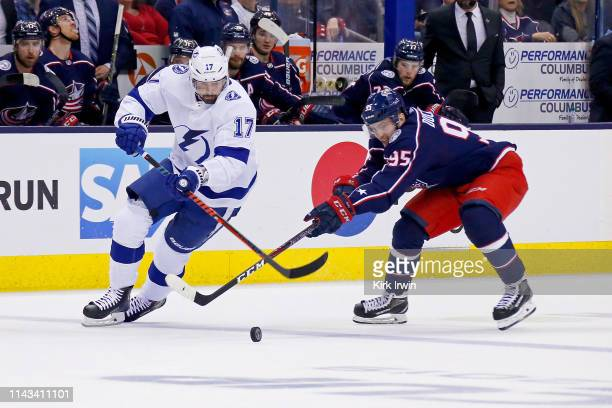 Alex Killorn of the Tampa Bay Lightning and Matt Duchene of the Columbus Blue Jackets battle for control of the puck in Game Four of the Eastern...